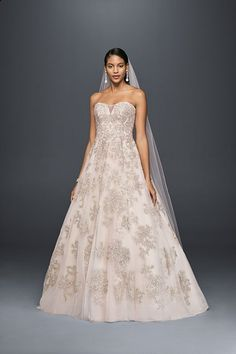 Oleg Cassini's lace blush wedding dress shimmers with over 5,000 beads and sequins. The A-line silhouette flatters every figure. Exclusively at David's Bridal.