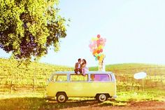VW van and balloons engagement photo