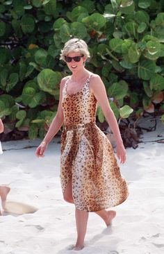 Sunning herself in a leopard skin swimsuit and sarong on holiday in the Carribbean's Necker Island.   - HouseBeautiful.com