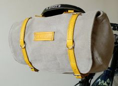 Classic Vintage Style Bicycle Bag $100. I hope they ship to Australia! The blue canvas with yellow strap is just dreamy!