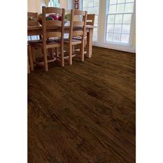The surface texture and warm chocolate brown color tones of this laminate flooring is rich and and inviting. It's equipped with a simple fold-down installation system that allows you to install your floor quickly without the need for glue.