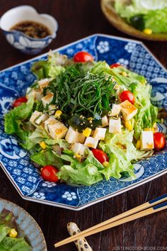 This easy Japanese Tofu Salad with Sesame Ponzu Dressing is a refreshing salad with leafy greens, tofu, corn, wakame seaweed, and fragrant Japanese herb – shiso leaves.  You'll love the tangy ponzu sauce too. It is super easy to make and goes well with many Japanese and Asian dishes. So make a big batch! #salad #tofusalad #vegetarian | Easy Japanese Recipes at JustOneCookbook.com Tofu Recipes, Asian Recipes, Healthy Dinner Recipes, Vegetarian Recipes, Gourmet Recipes, Vegetarian Salad, Healthy Meals, Easy Recipes, Japanese Salad