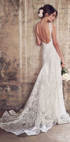 Wedding Dress by Anna Campbell -Jamie Dress | Bold, unique corded lace, embroidered with sequins, shimmer bridal gown | Romantic Wedding gown with multiple skirt options, including a flowy lace #weddingdress #weddingdresses #bridalgown #bridal #bridalgowns #weddinggown #bridetobe #weddings #bride #weddinginspiration #dreamdress #fashionista #weddingideas #bridalcollection #bridaldress #fashion #bellethemagazine #ido #dress