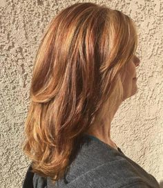 Medium Auburn Layered Hairstyle | For more style inspiration visit 40plusstyle.com