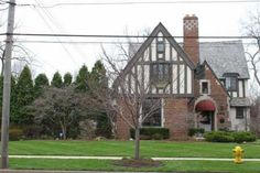 ONE OF A KIND AUTHENTIC ENGLISH TUDOR HOME WITH 6 YEAR OLD WOOD SHAKE ROOF, WAVE PLASTER WALLS, ROPE CROWN MOLDING, OAK FLOORS THROUGHOUT ON AN APPROXIMATE ONE ACRE RIVERFRONT LOT. NUMEROUS UPDATES INCLUDING: PELLA ARCHITECT SERIES WINDOWS, CENTRAL AIR, 200 AMP ELECTRIC, COPPER PLUMBING, CONCRETE DRIVE, HEATED BASEMENT FLOOR, CUSTOM CABINETS AND GRANITE COUNTER TOPS. FULL HOUSE GENERATOR.
