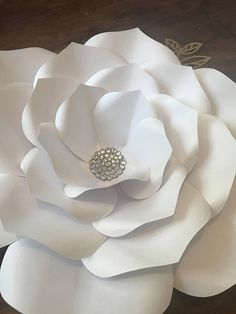 This beautiful paper flower set is perfect to decorate your event or use as home decor. This set can be recreated in your choice of colors, some premium colors may incur and up charge please check before ordering. Includes: 5 Large paper flowers (16-18) 5 Medium paper flowers