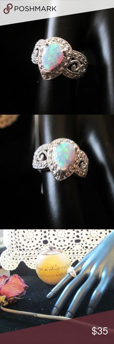 SALE** Fire Opal Filigree Silver Ring NEW! Beautiful Filigree Fire Opal ring in beautiful setting.  Stamped 925 Guaranteed Silver.  Size 7  Thanks for Stopping in my closet. Come again soon! Jewelry Rings