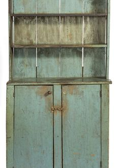 Early American step back cupboard in blue paint
