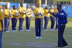 Advocate staff photo by RICHARD ALAN HANNON -- Former Southern University marching band director Isaac Greggs leads the Southern alumni band prior to the Jaguars homecoming game against the Alcorn State Braves on Saturday in A.W. Mumford Stadium.