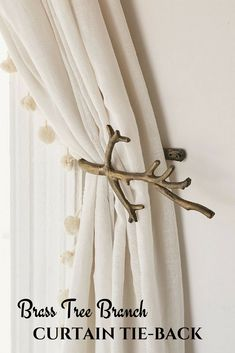 Hold your curtains back with these stylish antiqued brass tie-backs in the shape of a tree branch. #ad #curtaintie-back #homedecor #livingroom #bedroom #decorideas