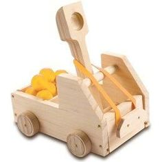 DIY Truck Catapult & Paint Kit | Imagine Toys.  You'll have a great time building this tabletop truck catapult with your child and then avoiding catapulted balls! Building Set includes all building materials; but a hammer & glue are needed.  We've also added paints & brushes so kids can decorate their catapult after they build it. Kit also includes truck graphic stickers, 5 small balls, rubber band. Difficulty level: beginner. Younger children will need adult assistance. For ages
