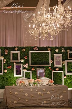 Nisie's Enchanted Florist -- Hanging chandeliers will transform any wedding reception into an elegant affair, nisiesenchanted, chandeliers, wedding reception, sweet heart table, wedding florals, floral wall