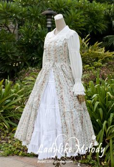I love the layers of white petticoats/slips and the lacy ruffled edges.THe ver dress is so pretty. THe colors are so feminine and lady like. Note the lacy collar.