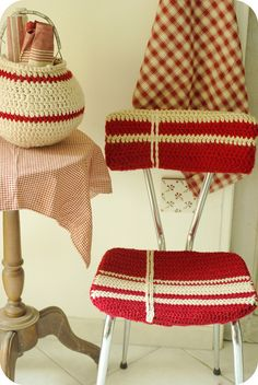 crocheted red and white chair cover.