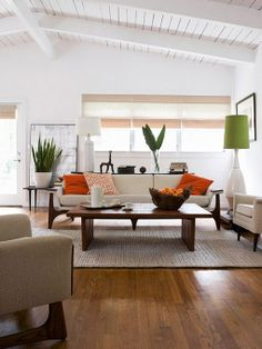 such a great color combo...fresh with pops of orange & green...and look at those floors!