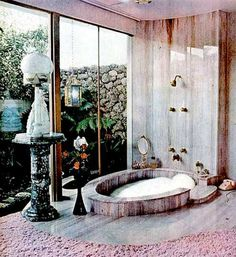 Love this 60s bathroom, with a sunken bathtub and a view!