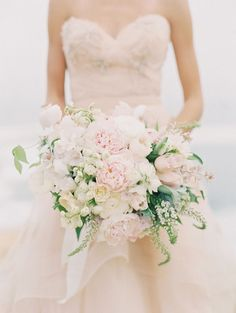 Blush and cream asymmetrical bridal bouquet | 12 Stunning Wedding Bouquets via @BelleMagazine