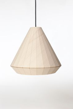 The wood veneer of this lamp is cut and engraved using a laser. The film backing functions as a hinge, making it possible to fold the veneer where it would normally break.