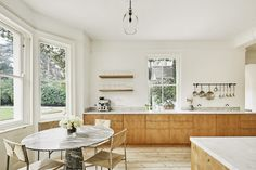 The kitchen cabinets were handmade in The Netherlands with smoked solid-oak doors and oak carcasses. The countertop is Carrara marble in A Serene English Country House Surrounded by Woodland - The Nordroom