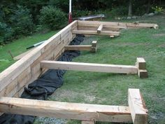 """This tutorial is created for beginners curious about building stone retaining walls, 3 feet in elevation or much shorter, utilizing a dry-walling or """"dry-stack"""" method. Various other products that cou Railroad Tie Retaining Wall, Building A Retaining Wall, Garden Retaining Wall, Stone Retaining Wall, Landscaping Retaining Walls, Building Stone, Building A Pergola, Sleeper Retaining Wall, Brick Garden"""