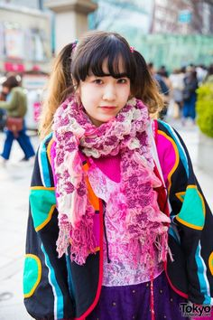 Twin-tailed Fuki's colorful ensemble includes pink tights, a lace and velvet onesie she bought in Shimokitazawa, and a geometric print jacket gifted by a friend. Pink ankle socks, Tokyo Bopper platforms, and a remake canvas tote bag, and accessories such as a pink ruffle scarf and knitted gloves completed her look.