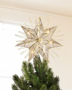 This topper is beautiful!  Balsam Hill really knocks the ball outta the field with their Christmas decor! #mybalsamhillhome. I love this tree topper!   Bring the dazzling elegance of modern simplicity to your home with Balsam Hill's Star Tree Topper.