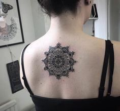 Mandala flower on back by Alex Bawn