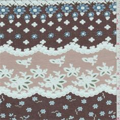 Mocha brown and dark beige horizontal stripe with a blue, forest, olive and white floral print that is accented with a burnout scallop design.This lightweight cotton/polyester fabric is very soft. $5.25 Compare to $12.00/yd