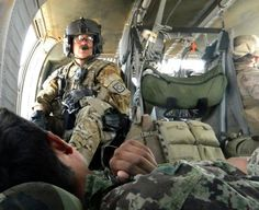 Army Sgt. Cliff Aughe, a flight medic with C Company, 1st Battalion, 171st Aviation Regiment, New Mexico Army National Guard, watches over a soldier from the Afghan National Army during an evacuation mission in Afghanistan. (U.S. Army photo by Sgt. Daniel Schroeder)