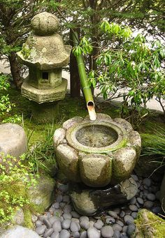 Japanese stone fountain with bamboo pipe.