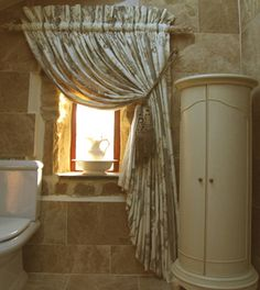 Single curtain in Timney Fowler print sheered onto the gilt finished pole. The amount of fullness and the gorgeous tassel tie backs makes a really opulent looking drape.