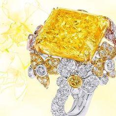 Anna's stunning 72 carats Fancy Intense Yellow Diamond Orchid Ring emits a…