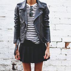 Black motorcycle jacket, striped top, black skirt