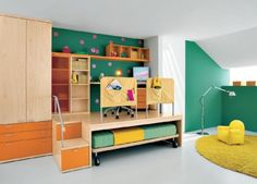 Another way to maximize all that space. Create a platform for your kid's mini library and slide his bed under it. Transform the stairs into slide out cabinets too.