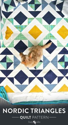 """This Nordic Triangles quilt pattern design gathers inspiration from classic Scandinavian prints. This quilt can have a rustic """"log cabin"""" aesthetic or be delicate and feminine based on the fabrics and fabric substrates you choose."""