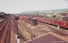 hown here are the roof of WORKS Tower in the foreground, the east- and westbound passenger tracks on the left, two westbound freight trains ready for dispatch, and two idling locomotives on the right. Abandoned Train, Pennsylvania Railroad, Railroad Photography, Train Pictures, Mack Trucks, Rolling Stock, Train Travel, Locomotive, Railroad Tracks