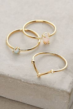 gold rings with pale pink + blue crystal stud features