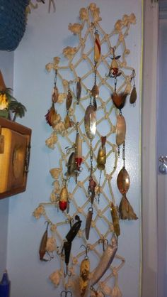I could decorate the new office this way...Old fishing lures