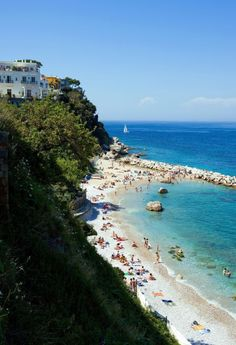 The Italian island of Capri is famous for its Blue Grotto and rocky shoreline. Pro tip: If you and you partner prefer to eat your way through vacation, the Da Luigi ai Faraglioni restaurant lets you eat, swim and sunbathe right out front.