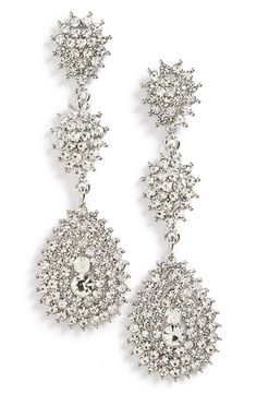 Swooning over these crystal-encrusted teardrop earrings that sparkle and shimmer for a vintage-chic statement.