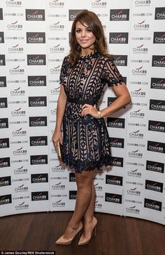 Lovely in lace:The show's Chloe Lewis looked pretty in a navy lace mini-dress with nude p...