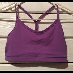 Lululemon Y bra. Size 6. Lululemon Y bra. Size 6. There is a slight stain on the right strap, shown in last pic. There are no rips, tears or piling - besides slight stain its in good shape. I can include pads if you like, please let me know if not I will and without. lululemon athletica Tops