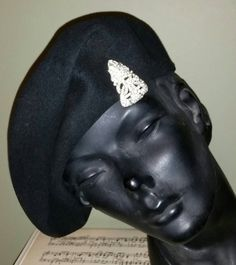 Check out this item in my Etsy shop https://www.etsy.com/listing/217551758/true-vintage-1930s-1940s-black-beret-hat