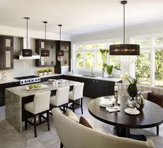 Regina Sturrock Design ~ Modern Kitchen Design. Love the dark cabinets and light-colored counter tops.