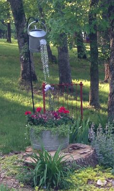 "Another borrowed idea. Crystal bead garland dripping from watering can. Perfect hanging from a shepherd's hook so it perpetually ""waters"" the washtub below."