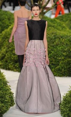 DIOR A design unlike any other at Paris haute couture fashion week, Raf Simons chooses the dress' thigh level to showcase his pristine blooms.