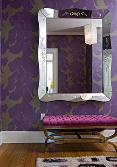 Love the wallpaper! And the footstool! And the mirror!