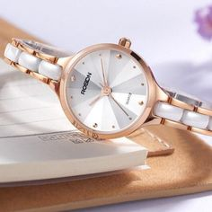 Reflect your grace wearing this attractive watch that looks fabulous with an intricately fashioned tungsten ceramic band. The premium-grade ceramic material and push-button clasp of this watch for women offer a comfortable feel and flattering fit. Beautified with multi-angle diamond design, this watch is a luxurious accessory to gauge your style factor.  #watchesforwomenclassy #luxurywatchesforwomenclassy #fashionwatchesforwomenclassy Female Watches, Ceramic Materials, Diamond Design, Luxury Watches, Fashion Watches, Bracelet Watch, Your Style, Quartz, Classy
