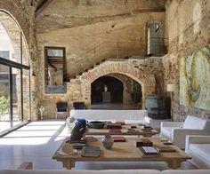 This gorgeous rustic country house in Cáceres, Spain was designed by Madrid based architect, painter and sculptor Kico Camacho, completed in 2010.