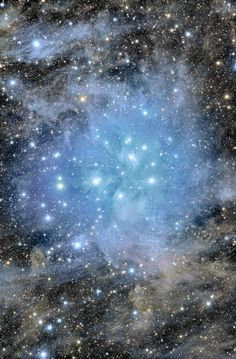 around 400 light years away lies the Pleiades star cluster |